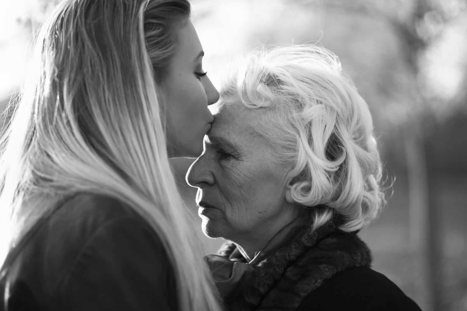 Grandmother and granddaughter in a park.